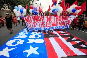 Protesters display a banner during a protest to denounce the visit of U.S. President Donald Trump, who will be attending the 31st Association of Southeast Asian Nations (ASEAN) leaders summit, in metro Manila, Philippines November 12, 2017. REUTERS/Romeo Ranoco