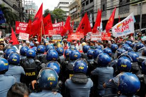 Anti-riot police officers block protesters trying to march towards the U.S. embassy during a rally against U.S. President Donald Trump's visit, in Manila, Philippines November 10, 2017.