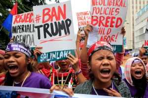 Members of the GABRIELA (Women's Group) shout anti-U.S. government slogans while denouncing the planned visit of U.S. President Donald Trump to attend the 31st Association of Southeast Asian Nations (ASEAN) leaders summit during a protest outside the U.S. embassy in metro Manila, Philippines November 9, 2017. REUTERS/Romeo Ranoco